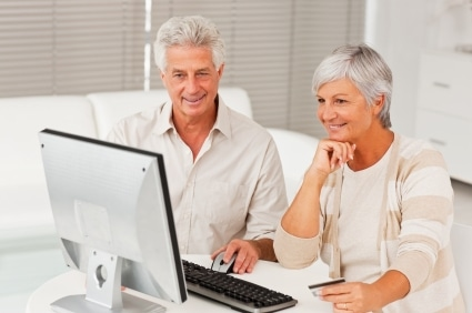 Elderly couple shopping from home using the internet